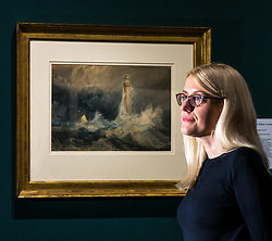 Pictured: Turner art exhibitionCurator Charlotte Topsfield admires the Bell Rock lighthouse painting by Turner. For more than a century the National Galleries of Scotland (NGS) have displayed an outstanding collection of Turner watercolours, from the 38 paintings bequeathed by Henry Vaughan in 1900. His will stipulated that the paintings should only be shown in January when daylight in Edinburgh is weak. The annual exhibition by artist Joseph Mallord William Turner (1775-1851) is supported by players of People's Postcode Lottery for the 7th year running. The focal point is a dramatic portrait of the Bell Rock lighthouse built by Robert Stevenson (1772-1850) which was commissioned 200 years ago by the lighthouse engineer to illustrate his book 'Account of the Building of Bell Rock Lighthouse'. Bell Rock is the oldest surviving rock lighthouse in the British Isles, first lit in 1811. It stands on a partially submerged reef near Angus, regarded by sailors as among the most dangerous places on the east coast of Scotland. The exhibition opens on New Year's Day at Scottish National Gallery and last for one month. 20 December 2018  <br /> <br /> Sally Anderson   EdinburghElitemedia.co.uk
