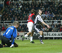 Photo. Andrew Unwin.Digitalsport<br /> Newcastle United v RCD Mallorca, UEFA Cup Fourth Round First Leg, St James Park, Newcastle upon Tyne 11/03/2004.<br /> Mallorca's Fernando Correa (c) wheels away after scoring while Newcastle's Shay Given (l) and Aaron Hughes (r) look dejected.