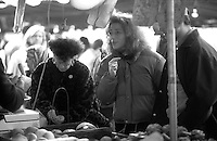 people shopping in French produce markets - photograph by Owen Franken