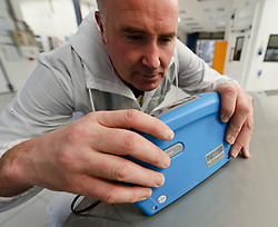 Erik van Dorp, Technical Specialist at AkzoNobel uses a Photospectrometer: Automatchic 3 - hand held color checking device which allows him to measure the car's exact color and find the right color formula in a matter of seconds, at the AkzoNobel Car Refinishes Instruction Center, (CRIC) in Sassenheim, the Netherlands, Wednesday, Dec. 22, 2010. Akzo Nobel NV, the world's biggest paint maker, reported a 21 percent increase in third quarter net income to 238 million euros. (Photo © Jock Fistick)