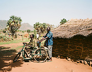 """NUBA MOUNTAINS, SUDAN – JUNE 9, 2018: Aid workers deliver gifts and relief. <br /> <br /> In 2011, the government of Sudan expelled all humanitarian groups from the country's Nuba Mountains. Since then, the Antonov aircraft has terrorized the Nuba people, dropping more than 4,080 bombs on hospitals, schools, marketplaces and churches. Today, vestiges of the Antonov riddle the landscapes of daily life, where more than 1 million Nuba live in famine conditions – quietly enduring the humanitarian blockade intended to drive them out of the region. The skies are mostly clear. Yet the collective memory of the bombings remains an open wound, and the Antonov itself a persistent threat. So frequent were the attacks that the Nuba nicknamed the high flying aircraft and its dismal hum: """"Gafal-nia ja,"""" they would declare, running to the hillsides. """"The loss of appetite has come."""""""