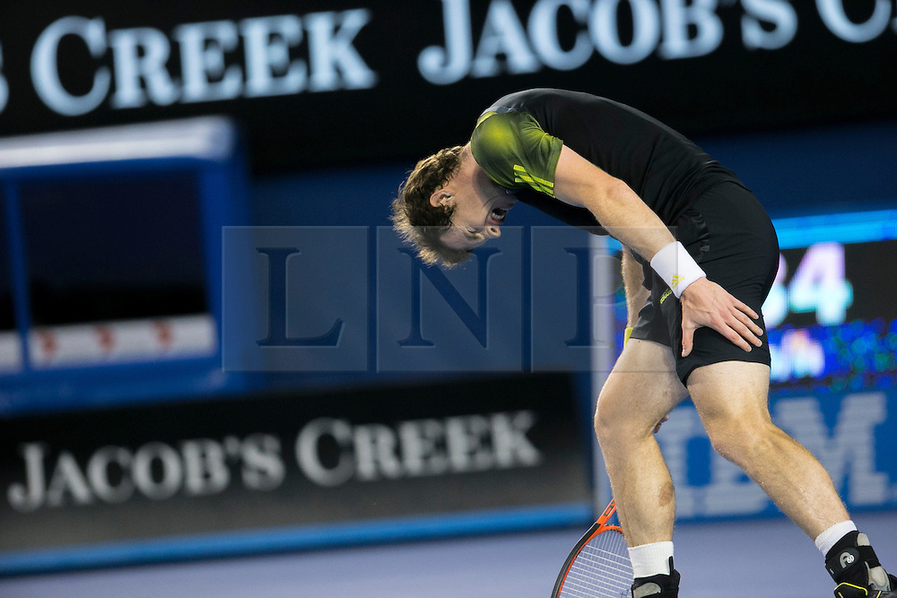 © Licensed to London News Pictures. 27/01/2013. Melbourne Park, Australia. Andy Murray holds onto his injured hamstring while screaming during the Mens Final between Novak Djokovic and Andy Murray of the Australian Open. Photo credit : Asanka Brendon Ratnayake/LNP