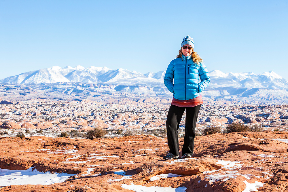 A middle aged woman posing for a picture in Arches National Park, Utah, USA.