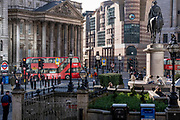 Reflected sunlight illuminates the Bank Triangle junction during a much quieter evening rush-hour during the third lockdown of the Coronavirus pandemic. Financial institutions, the statue of the Duke of Wellington, Mansion House and the Bank of England are located here, in the heart of the City of London, aka Square Mile, on 9th March 2021, in London, England.