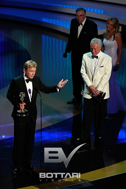 From left, Pat Sajak and Alex Trebek accept the Lifetime Achievement Award onstage at the Daytime Emmy Awards on Sunday June 19, 2011 in Las Vegas. (AP Photo/Jeff Bottari)