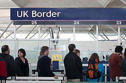 © licensed to London News Pictures. London, UK 08/04/2012. Passengers waiting in the queue outside the UK Border of Stansted Airport, this afternoon (08/04/12) . Photo credit: Tolga Akmen/LNP