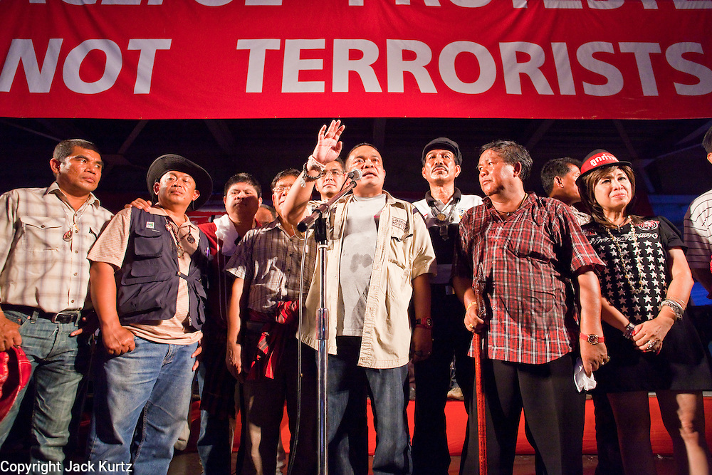 """10 MAY 2010 - BANGKOK, THAILAND: Red Shirt core leader Jutaporn Prompan(CENTER AT MICROPHONE) and other Red Shirt leaders tell their supporters that they've accepted the government """"Road Map for Reconciliation"""" with just one caveat and that their protest could be ending soon. The crowd greeted the news with a roar of approval. The Red Shirt leaders met with their supporters Monday evening and specified the terms for ending their protest in Bangkok and occupation of the Ratchaprasong Intersection in the heart of the Thai capital's shopping district. The accepted the Prime Minister's """"Road Map for Reconciliation"""" and added one condition, that Thai Deputy Prime Minister Suthep Thaugsuban turn himself into police for his role in allegedly ordering the security forces attack on Red Shirts protestors on April 10 that resulted in more than 20 deaths and 800 injuries. Late Monday night Suthep said he would meet with police Tuesday morning. The Red Shirts haven't confirmed if that meets their demand, so the status of the protest is unknown.   PHOTO BY JACK KURTZ"""