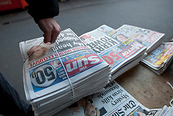 © licensed to London News Pictures. London, UK 26/02/2012. The Sun on Sunday's first edition arrives to a newsagent in central London, this morning (26/02/12). Photo credit: Tolga Akmen/LNP