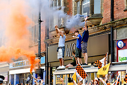 Supporters let off flares during the winner's parade through Wolverhampton.
