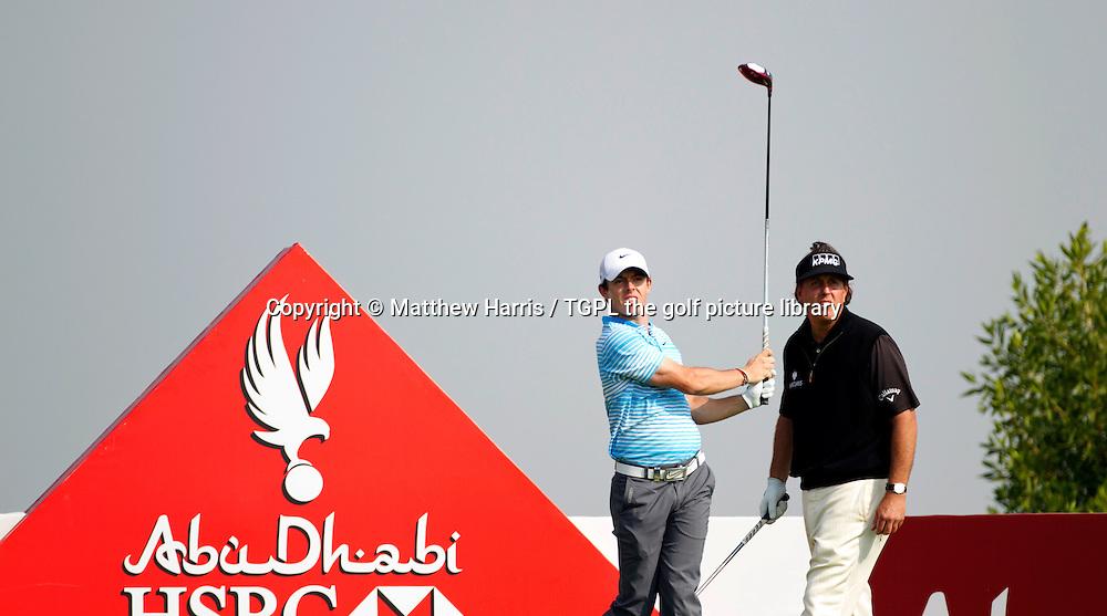 Rory MCILROY (NIR) and Phil MICKLESON (USA) during first round HSBC Abu Dhabi Championship 2014,Abu Dhabi Golf Club,Abu Dhabi,UAE.