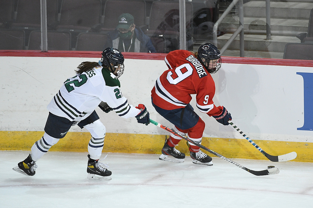 ERIE, PA - MARCH 05: Maggy Burbidge #9 of the Robert Morris Colonials controls the puck under pressure from Alexandria Weiss #22 of the Mercyhurst Lakers in the third period during the game at the Erie Insurance Arena on March 5, 2021 in Erie, Pennsylvania. (Photo by Justin Berl/Robert Morris Athletics)