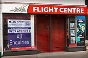 The Flight Centre is one of the many closed stores on Oxford Street, during the third lockdown of the Coronavirus pandemic, on 3rd March 2021, in London, United Kingdom. Europe's premier shopping destination faces its biggest threat in decades. Travel companies are severely hit as  current UK COVID-19 restrictions, people must stay at home. They must not travel, including abroad, unless they have a legally permitted reason to do so. It is illegal to travel abroad for holidays and other leisure purposes.