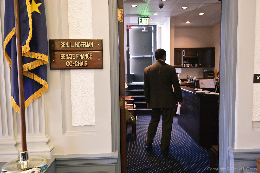 Rep. Chris Tuck (D) visits  the offices of state senator Lyman Hoffman seeking support for his bill.