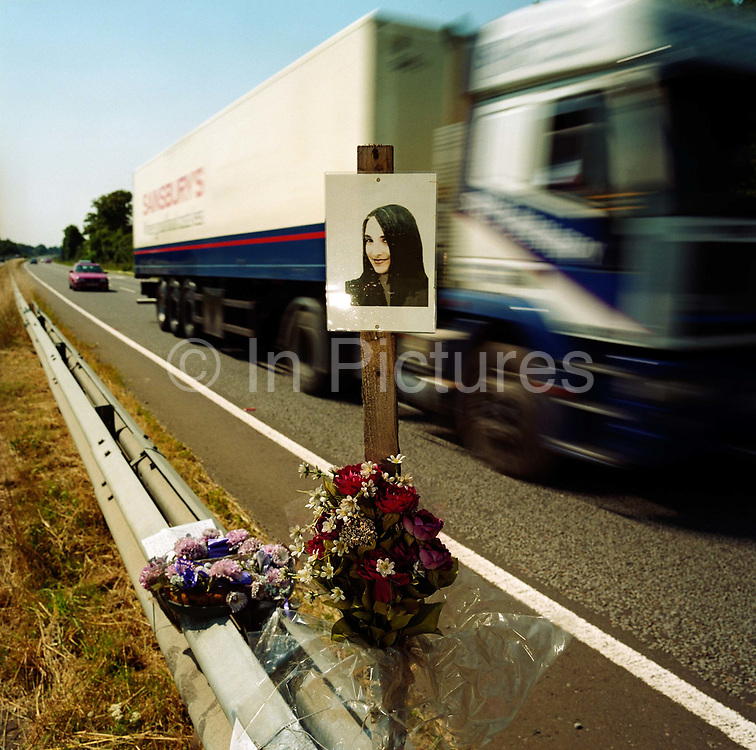 """A memorial has been placed where 'Amy' died on the A27 near Binstead, Sussex, England. If we drove past this place where someone's life ended, the victim would just be a statistic but flowers are left to die too with touching poems written by family and loved-ones: """"To Amy (aged 14)/In my heart there is a picture worth more than silver and gold/it is a picture of my auntie Amy/whose memory will never grow old/Death comes so very quick/you never know when you're going to be picked."""" From a project about makeshift shrines: """"Britons have long installed memorials in the landscape: Statues and monuments to war heroes, Princesses and the socially privileged. But nowadays we lay wreaths to the ordinary who die suddenly - killed as pedestrians, as drivers or by alcohol, all celebrated on our roadsides and in cities with simple, haunting roadside remembrances"""