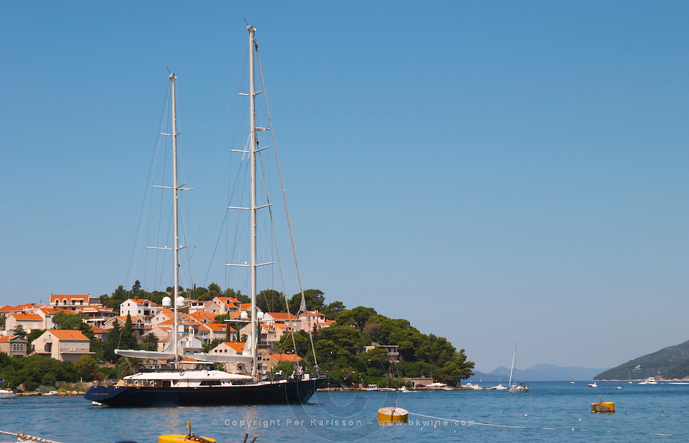 A very big luxurious pleasure sailing ship yacht with two masts, called Santa Maria leaving harbour. Luka Gruz harbour. Dubrovnik, new city. Dalmatian Coast, Croatia, Europe.