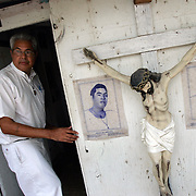 Alberto Salinas looks back as he enters the small sanctuary where he channels the spirit of the Mexican folk saint Niño Fidencio at his home in Edinburg. Salinas has been a curendero and channeler of Fidencio since 1978.<br /> Nathan Lambrecht/The Monitor