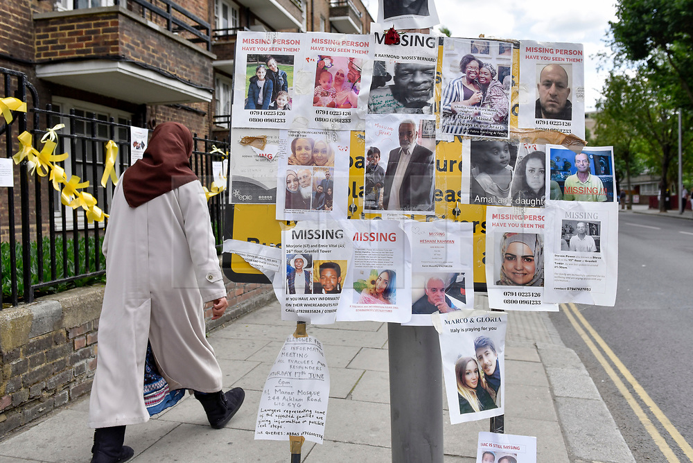 © Licensed to London News Pictures. 23/06/2017. London, UK. Missing persons and other messages are seen on a road sign.  Nine days on, police have reported that the Grenfell Tower fire in west London started in a fridge-freezer, and outside cladding and insulation failed safety tests. Photo credit : Stephen Chung/LNP