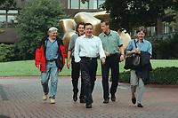 """16 JUL 1999 - BONN, GERMANY:<br /> Frank Walter Steinmeier, Staatssekretär im Bundeskanzleramt, Bodyguard, Gerhard Schröder, Bundeskanzler, Bodyguard, Sigrid Krampitz, Leiterin des Kanzlerbüros, zu Fuß auf dem Weg zur SPD Radtour """"Abschied vom Rhein"""", Bundeskanzleramt<br /> IMAGE: 19990716-01/01-24<br /> KEYWORDS: Gerhard Schroeder"""