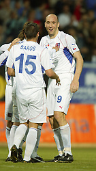 TEPLICE, CZECH REPUBLIC - Wednesday, April 30, 2003: Little and large... Czech Republic's goalscorers Jan Koller (r) and Milan Baros celebarte during their 4-0 friendly victory over Turkey at the Teplice Stadion Na Stinadlech. (Pic by David Rawcliffe/Propaganda)