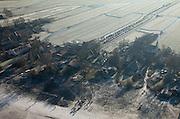 Nederland, Noord-Holland, Holysloot, 10-01-2009; klassiek winters tafereel, schaatsers op de Holysloter Die, geparkeerde auto's op Bloemendalergouw, berijpte weilanden; .classic winter scene, skaters on the Holysloter Die, parked cars on Bloemendaler Gouw and frosted meadows;.schaats, schaatsen, ijs, ijspret, pret, ijsbaan, natuurijs, schaatsen rijden, winter, koud, vriezen, min nul, beneden nul, koud, celsius, skating, ice skating, ice, fun, skating rink, natural, skate, snow, cold, freezing, minus zero, below zero, cold, winterlandscahp, winter landscape, tocht, toertocht, koek en zopie . .luchtfoto (toeslag); aerial photo (additional fee required); .foto Siebe Swart / photo Siebe Swart
