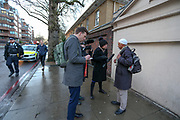 Press members interviewing eyewitnesses near London's Central Mosque after an imam was stabbed in the neck while performing the call to an afternoon prayer on Thursday, Feb. 20, 2020. (AP Photo/Vudi Xhymshiti)