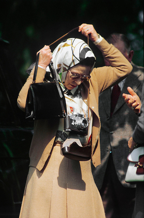 The Queen seen off duty with her Leica camera at the Royal Windsor Horse Show in May 1987. Photograph by Jayne Fincher