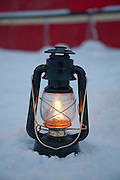 An oil lantern lit near the Noorderlicht, a Dutch Schooner. Each year the Nooderlicht is frozen into the ice in Spitsbergen, and serves as an excellent base camp in the wilderness, perfect for spotting polar bears. Spitsbergen is the largest island of the arctic archipelago Svalbard, of Norway