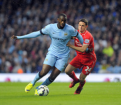 Manchester City's Yaya Toure battles for the ball with Liverpool's Joe Allen - Photo mandatory by-line: Joe Meredith/JMP - Mobile: 07966 386802 25/08/2014 - SPORT - FOOTBALL - Manchester - Etihad Stadium - Manchester City v Liverpool - Barclays Premier League