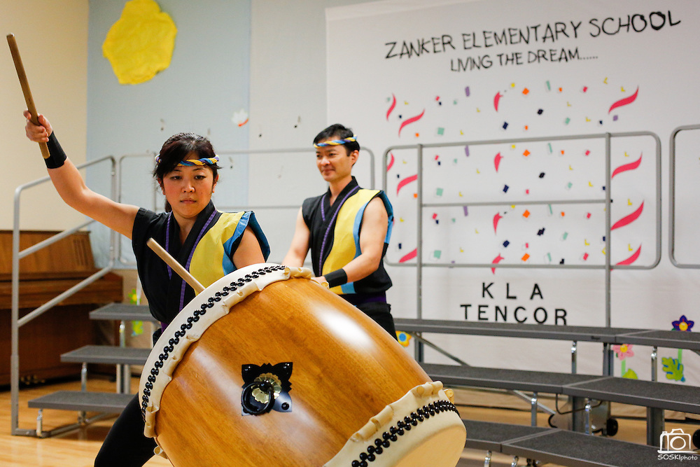 Meg Suzuki, foreground, and Franco Imperial of the San Jose Taiko perform during the KLA-Tencor Computer Lab opening ceremony at Zanker Elementary School in Milpitas, California, on February 27, 2013. (Stan Olszewski/SOSKIphoto)