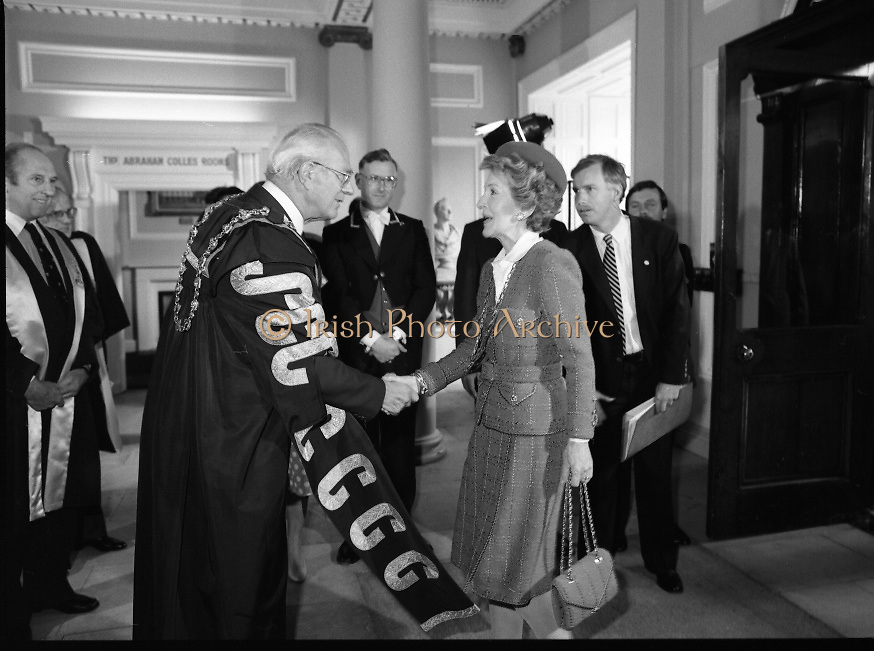 Nancy Reagan .Visits the Royal College Of Surgeons..St Stephens Green, Dublin..1984..04.06.1984.06.04.1984.4th June 1984..Nancy Reagan visited the Royal College of Surgeons where she unveilled a portrait of her late father.Her father, Dr Loyal Davis was an Honorary Fellow of the college. Mrs Reagan then presented the portrait to the college..Image of Mrs Nancy Reagan as she is wecomed to the Royal College Of Surgeons as she is welcomed by Professor Eoin O'Malley,president of the college..