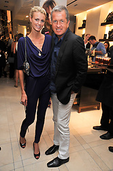 MARIO TESTINO and JACQUETTA WHEELER at a reception hosted by Vogue and Burberry to celebrate the launch of Fashions Night Out - held at Burberry, 21-23 Bond Street, London on 10th September 2009.