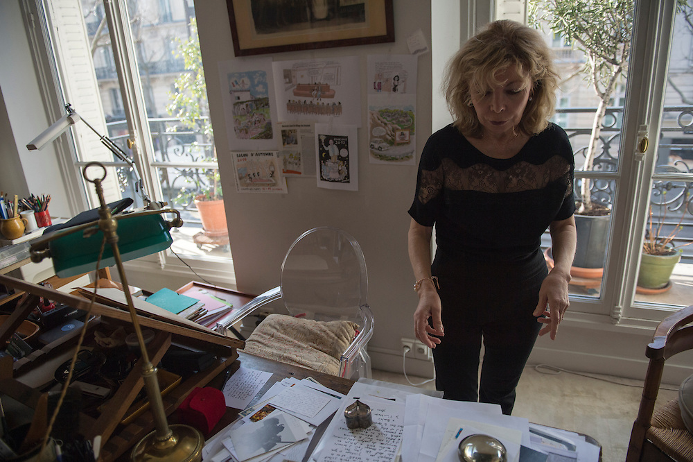 """March 6, 2015, Paris, France. Writer Maryse Wolinski (1943, Algiers) in Georges Wolinski's artist studio in the Paris' apartment where Georges and Maryse Wolinski used to live. Two month after the death of Georges Wolinski (1934 –2015), the apartment is full of souvenirs. <br /> In 2016 Maryse Wolinski published the book """"Chérie, je vais à Charlie"""" about her husband and the attack on Charlie Hebdo. The cartoonist Georges Wolinski was 80 years old when he was murdered by the French jihadists Chérif en Saïd Kouachi, he was one of the 12 victims of the massacre in the Charlie Hebdo offices on January 7, 2015 in Paris. Charlie Hebdo published caricatures of Mohammed, considered blasphemous by some Muslims. During his life, Georges Wolinski defended freedom, secularism and humour and was one of the major political cartoonists in France. The couple was married and had lived for 47 years together. Photo: Steven Wassenaar."""