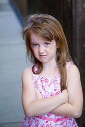 Little girl sulking,