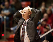 Utah Head Coach Anthony Levrets holds his head in disbelief at a foul call during the first half of the NCAA Women's Basketball game between Utah and BYU at the Jon M. Huntsman Center, Saturday, Dec. 8, 2012.