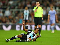 NEWCASTLE UPON TYNE, ENGLAND - SEPTEMBER 17: Isaac Hayden of Newcastle United is fouled during the Premier League match between Newcastle United and Leeds United at St. James Park on September 17, 2021 in Newcastle upon Tyne, England. (Photo by MB Media)