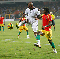 Photo: Steve Bond/Richard Lane Photography.<br />Ghana v Guinea. Africa Cup of Nations. 20/01/2008. Junior Agogo (L) tries to shield the ball from Oumar Kalabane (R)