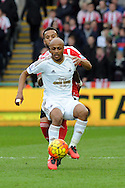 Swansea's Andre Ayew holds off the ball from Southampton's Ryan Bertrand. Barclays Premier league match, Swansea city v Southampton at the Liberty Stadium in Swansea, South Wales on Saturday 13th February 2016.<br /> pic by  Carl Robertson, Andrew Orchard sports photography.