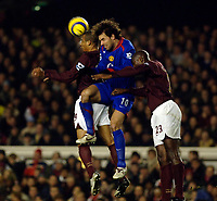 Photo: Daniel Hambury.<br />Arsenal v Manchester United. The Barclays Premiership.<br />03/01/2006.<br />Arsenal's Sol Campbell and Gilberto stop United's Ruud van Nistlerooy.