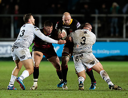 Dragons' Rynard Landman with team-mate Elliot Dee under pressure from Ospreys' Dimitri Arhip and Ashley Beck<br /> <br /> Photographer Simon King/Replay Images<br /> <br /> Guinness Pro14 Round 12 - Dragons v Cardiff Blues - Sunday 31st December 2017 - Rodney Parade - Newport<br /> <br /> World Copyright © 2017 Replay Images. All rights reserved. info@replayimages.co.uk - http://replayimages.co.uk