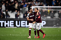 Football - 2021 / 2022 UEFA Europa League - Group H - Round Two - West Ham United vs Rapid Vienna - London Stadium - Thursday 30th September<br /> <br /> West Ham United's Said Benrahma with Mark Noble at the final whistle.<br /> <br /> COLORSPORT/Ashley Western