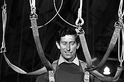 Prince Charles, 29, after he struggled into a flying harness during ground training at RAF Brize Norton. The Prince decided to undertake the parachute course and earn his parachute wings after he was appointed Colonel-in-Chief of the regiment last October.