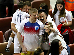 England goalkeeper Jordan Pickford poses for a selfie in the stands after the FIFA World Cup, Semi Final match at the Luzhniki Stadium, Moscow.