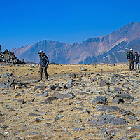 An archaeology team near an ancient village site at 12,400' in California's White Mountains, the highest Native American settlement in the United States. 14,252' White Mountain Peak rises in the background.
