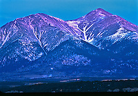 "Sunrise over 14,229 ft. Mount Shavano of the Sawatch Mountains, Colorado.  USA.  A figure of the ""Angel Of Shavano""  seen in the snow."