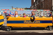 A toy train car pulls little cowboys and cowgirls during the Cheyenne Frontier Days parade through the state capital July 23, 2015 in Cheyenne, Wyoming. Frontier Days celebrates the cowboy traditions of the west with a rodeo, parade and fair.