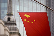 The Chinese national flag hangs from the Bank of China's offices in the City of London, England UK. At a time when economic and property investment agreements between Britain and China were confirmed, the Chinese communist state's presence in the UK capital is becoming more obvious.