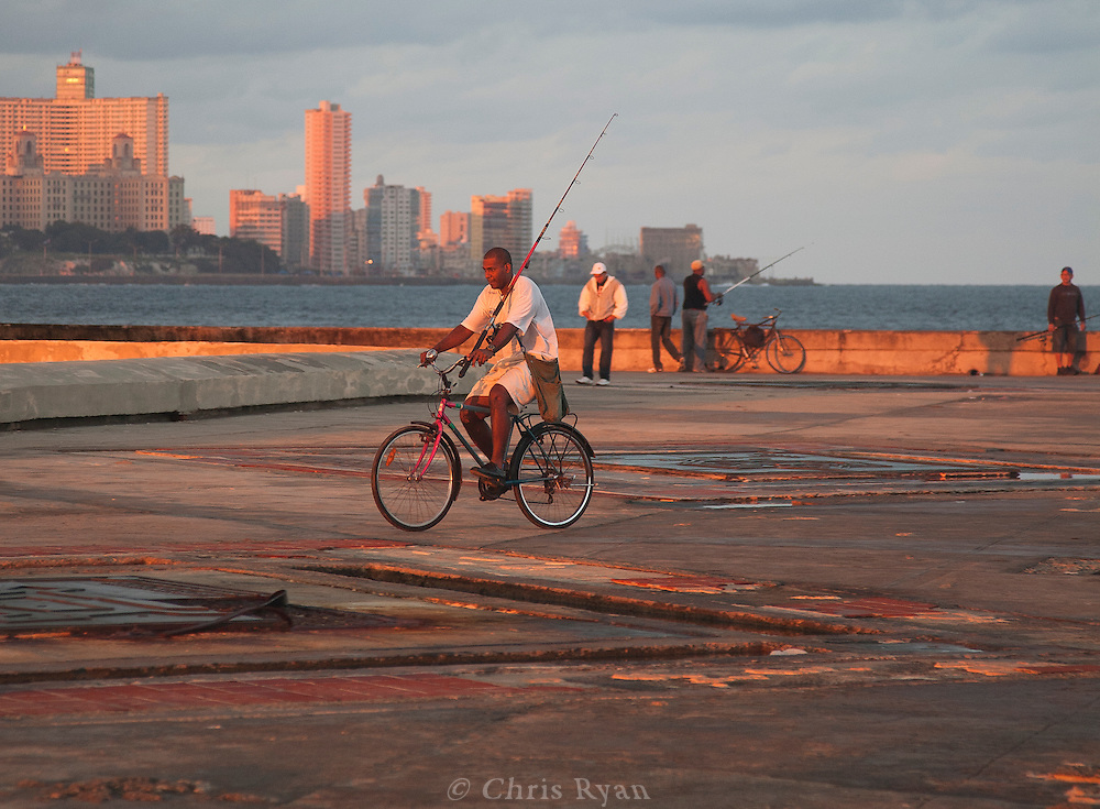 Fisherman at sunrise on the Malecon, Havana, Cuba