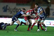Rhys Patchell of the Scarlets is tackled by Tom McCartney of Connacht (l). Guinness Pro12 rugby match, Scarlets  v Connacht at the Parc y Scarlets in Llanelli, West Wales on Saturday 24th September 2016.<br /> pic by  Andrew Orchard, Andrew Orchard sports photography.