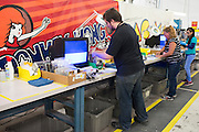Employees test and refurbish games at the GameStop retro classics console games refurbishment center in Grapevine, Texas on June 24, 2015. (Cooper Neill for Mashable)