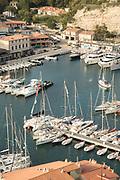 High angle view sailboats on harbor in town, Bonifacio, Corsica, France